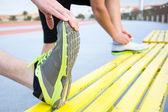 Men stretching in running track — Stock Photo