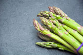 Asparagus on slate table — Stock Photo