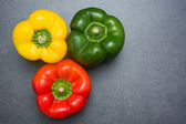 Peppers on slate table — Stock Photo