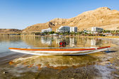Boat on the shores of the dead sea at dawn, Israel — Stock Photo