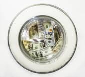 Dollar bills in the drum of the washing machine — Stockfoto