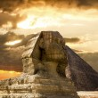 The Sphinx and the pyramid of Cheops in Giza Egipt  at sunset — Stock Photo #62203871
