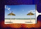 Beach landscape in rain wiped the wet glass — Stock Photo