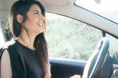 Female driver in a sunny day — Stock Photo