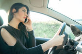Female driver with his smart phone — Stock Photo