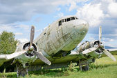 Airplane wreck in a field — Stock Photo