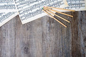 Musical scores with pencils on a table — Stock Photo