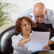 Senior couple looks at a Document — Stock Photo #54992363