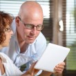 A senior couple watching a digital tablet — Stock Photo #54996347