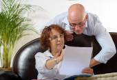 Senior couple looks at a Document — Stock Photo