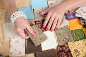 Close up of woman's hand sewing patchwork — Stock Photo