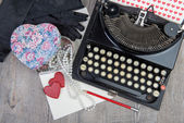 Gift, hearts and typewriter for Valentine's day — Stock Photo