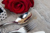 Valentine day's gift  with red rose and cutlery — Stock Photo