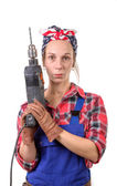 Vintage pretty young woman with a drill — Stock Photo