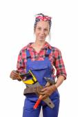 Pretty young woman with tools to tinkering — Stock Photo
