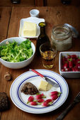 Plate with radish and butter on a table — ストック写真