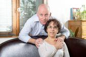 Senior couple on a sofa — Stock Photo