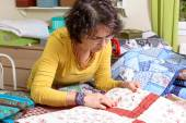 Dressmaker working on her patchwork — Stock Photo