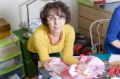 Dressmaker working on her quilt — Stock Photo