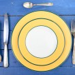 Plate with silver cutlery on an old table — Stock Photo #68586901