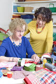 Two women working on their patchwork — Stock Photo