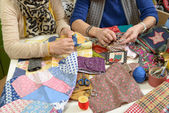 Two women working on their quilting — Stock Photo