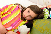 A little girl in her bed has a stomachache — Stock Photo