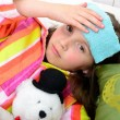 A little girl in her bed has a headache — Stock Photo #71059721