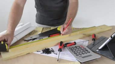 A man made a piece of furniture with   tools — Stock Video
