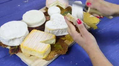 A young woman preparing a slice of bread and cheese — Stock Video