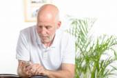 A man of middle age on phone — Stock Photo