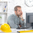 A young engineer pensive at his computer — Stock Photo #79184782