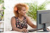 A young black secretary working with a computer — Stock Photo
