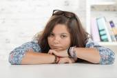 Portrait of a teenage girl on her desk — Stock Photo