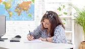 A teenager working homework — Stock Photo
