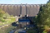 The Claerwen reservoir. Towering dam from below. — Stock Photo