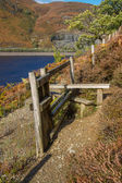 Wooden  Stile Style, over fence, with bracken. Lake and mountain — Stock Photo