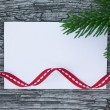 Christmas card: empty paper form with fir-tree branches and red — Foto de Stock   #53474239