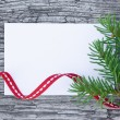 Christmas card: empty paper form with fir-tree branches and red — Photo #53474241