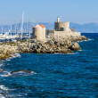 Harbor windmills and lighthouse. Rhodes, Greece — Stock Photo #57395631