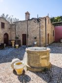Courtyard and well at Ancient Church. Rhodes. Greece — Stock Photo