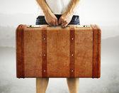 Men holding leather suitcase — Stockfoto