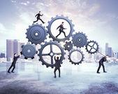 Businessmen pushing gears — Stock Photo