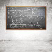 Drawing formula on chalk board — Stock Photo