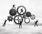 Five businessmen runs gears — Stock Photo