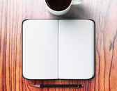 Blank diary, cup of coffee and pen — Stock Photo