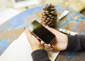 Girl with cell phone and ink drawing — Stock Photo