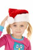 Blue eyed blond girl touching her santa hat — Stock Photo