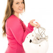 Female model wearing pink holding an American football helmet — Stock Photo #65483185