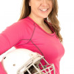 Young brunette female model holding American football helmet — Stock Photo #65483187
